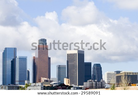 Los Angeles skyline against blue sky with clouds. - stock photo