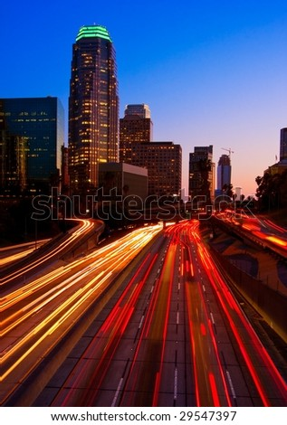 Los Angeles Skyline and Freeway at Sunset - stock photo