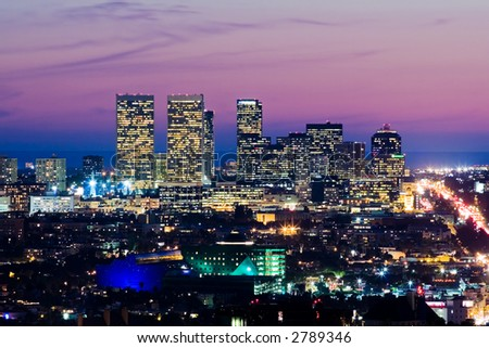 Los Angeles skyline at dusk. View of Century City and Pacific Ocean. - stock photo
