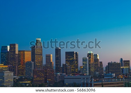Los Angeles skyline at dusk with blue night sky.