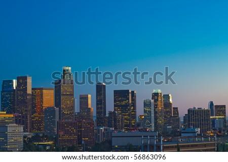 Los Angeles skyline at dusk with blue night sky. - stock photo