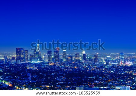 Los Angeles skyline at night with a clear sky. - stock photo