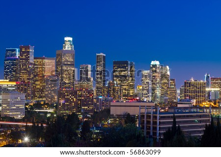 Los Angeles skyline at night with blue night sky.