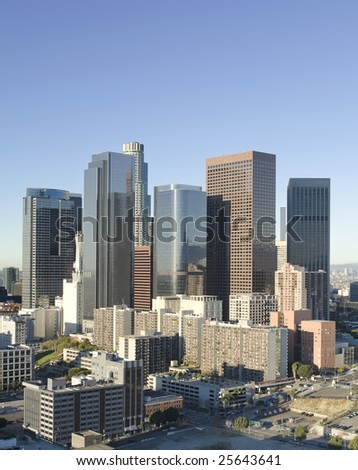 Los Angeles skyline at sunrise on a bright, sunny day. - stock photo