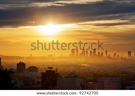 Los Angeles skyline at sunrise, view from Hollywood Hills. - stock photo