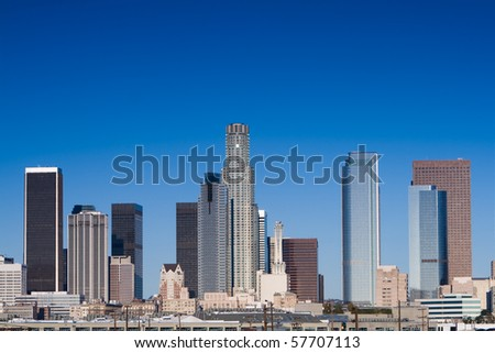 Los Angeles skyline on a sunny day with blue sky. - stock photo