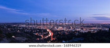 Los Angeles skyline panoramic at sunset - stock photo