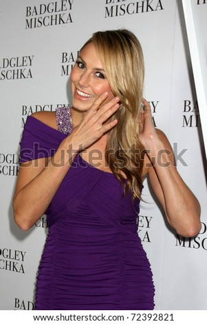 LOS ANGELES -  2:  Stacy Keibler arrives at the Badgley Mischka Flagship Store Opening at Badgley Mischka on Rodeo Drive on March 2, 2011 in Beverly Hills, CA