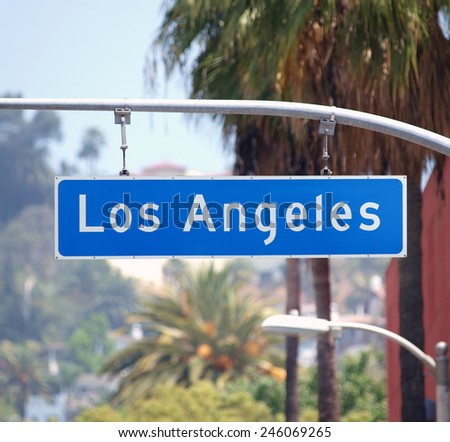 Los Angeles street sign with palm trees in Southern California.   - stock photo