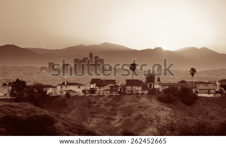 Los Angeles sunrise with mountain and buildings - stock photo