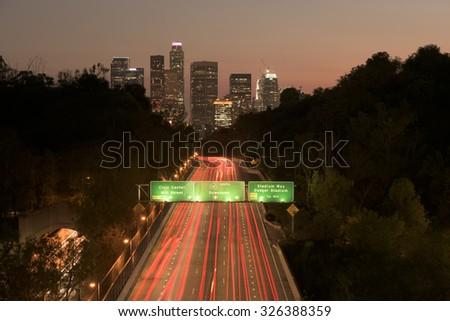 Los Angeles sunset highway traffic skyline  - stock photo