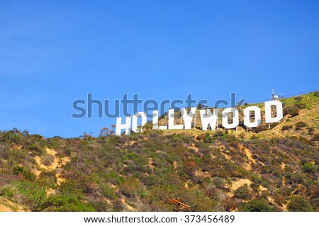 LOS ANGELES, THE UNITED STATES - APRIL 8, 2014 : The Hollywood Sign is a landmark and American cultural icon located in Los Angeles, California. It is situated on Mount Lee, in the Hollywood Hills. - stock photo