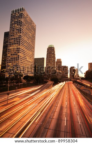 Los Angeles, Urban City at Sunset with Freeway Trafic - stock photo