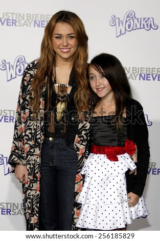 "LOS ANGELES, USA - FEBRUARY 8: Miley Cyrus at the Los Angeles Premiere of ""Justin Bieber: Never Say Never"" held at the Nokia Theatre L.A. Live in Los Angeles, USA on February 8, 2011. - stock photo"
