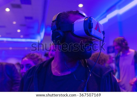 Los Angeles, USA - January 23, 2016: Man tries virtual reality Samsung Gear VR headset during VRLA Expo Winter, virtual reality exposition, at the Los Angeles Convention Center. - stock photo