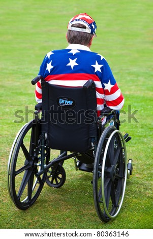 LOS ANGELES, USA - JULY 4 : Disabled American Vietnam veteran in a wheelchair at the Pierce Brothers Westwood Village Memorial Park Cemetery in Los Angeles, USA on July 4, 2011 - stock photo