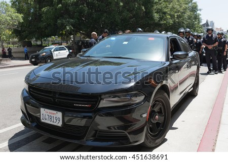 Los Angeles, USA - July 12, 2016 - Officers during march on City Hall following ruling on LAPD fatal shooting of African American female Redel Jones - stock photo