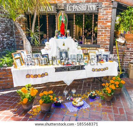 LOS ANGELES, USA - JULY 5: photos of a dead person at an altar in olvera street on July 5, 2008 in Los Angeles, USA. Olvera Street is in the oldest part of Downtown Los Angeles, USA. - stock photo