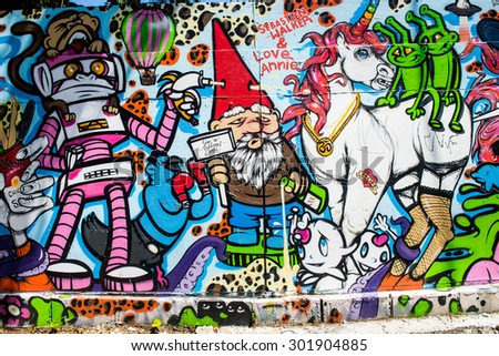 Los Angeles, USA - July 25: Wall graffiti on streets of west Los Angeles, CA on July 25, 2015. - stock photo