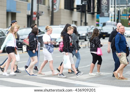 LOS ANGELES, USA - JUNE 11, 2016: The famous Hollywood blvd with tourists and visitors  in Los Angeles, USA.  - stock photo
