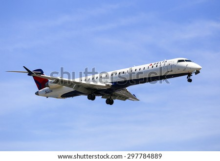 LOS ANGELES, USA - MAY 30, 2015: An airplane of Delta Airlines landing at Los Angeles International Airport.