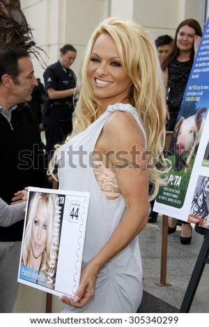 LOS ANGELES, USA - NOVEMBER 29, 2011: PETA Goes Postal: Pamela Anderson unveils Vegetarian Icons Postage Sheet held at the Hollywood Post Office in Hollywood, USA. - stock photo