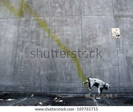 LOS ANGELES, USA - OCTOBER 17: Banksy graffiti on a wall (Pissing dog) on October 17, 2011 in Los Angeles. Banksy's first film, Exit Through the Gift Shop, was nominated for the Academy Award. - stock photo