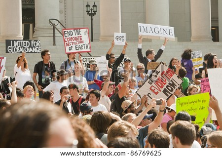 LOS ANGELES, USA - OCTOBER 15: Demonstrators March in the Occupy LA Protest through downtown Los Angeles to the City Hall on October 15, 2011. - stock photo