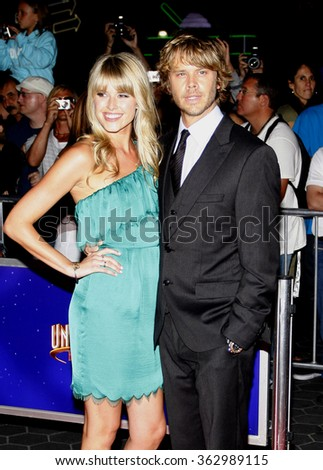 "LOS ANGELES, USA - Sarah Wright and Eric Christian Olsen at the Los Angeles Premiere of ""The Thing"" held at the Universal Studios Hollywood in Hollywood, USA on October 10, 2011. - stock photo"