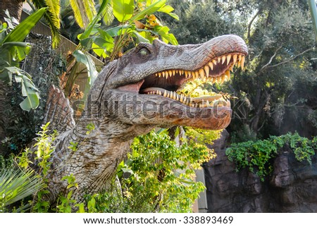 LOS ANGELES, USA - SEP 27, 2015: Indominus Rex from Jurassic World area in the Universal Studios Hollywood Park. Jurassic Park is a 1993 American adventure film  by Steven Spielberg - stock photo