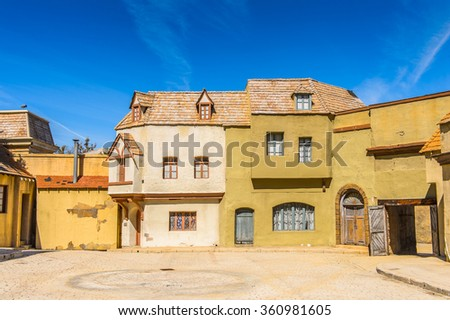 LOS ANGELES, USA - SEP 27, 2015: Medieval buildings for the Moster movies at the Hollywood Universal Studios. Universal Pictures Inc was created on June 10, 1912 - stock photo