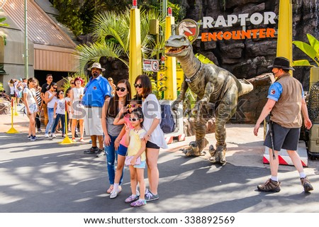 LOS ANGELES, USA - SEP 27, 2015: Velociraptor encounter attraction at Jurassic Park in the Universal Studios Hollywood Park. Jurassic Park is a 1993 American adventure film  by Steven Spielberg - stock photo