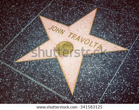 LOS ANGELES, USA - SEPTEMBER 20: Hollywood walk of fame on September 20, 2015 in Los Angeles, United States. It has stars embedded in the sidewalks along Hollywood Boulevard.