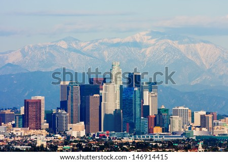 Los Angeles with snowy mountains in the background - stock photo