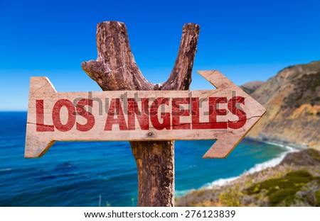 Los Angeles wooden sign with coast background - stock photo