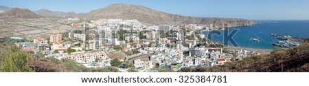 Los Cristianos, Canary Islands - March 25, 2012 - Picture taken from mountain above Los Cristianos, aerial view over Los Christianos and town, Canary Islands, March 25, 2015 - stock photo