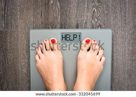 Lose weight concept with person on a scale measuring kilograms - stock photo