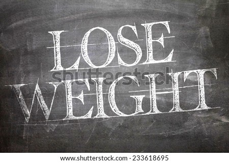 Lose Weight written on blackboard - stock photo