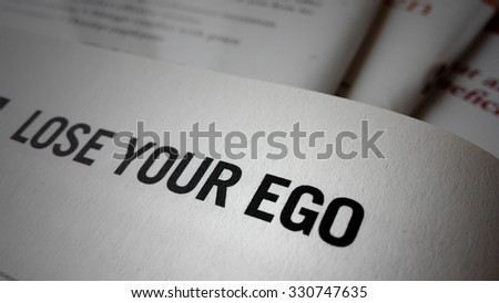 Lose your ego word on a book. Business success concept