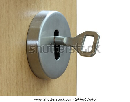 loseup of an keyhole with key on a wooden  door - stock photo