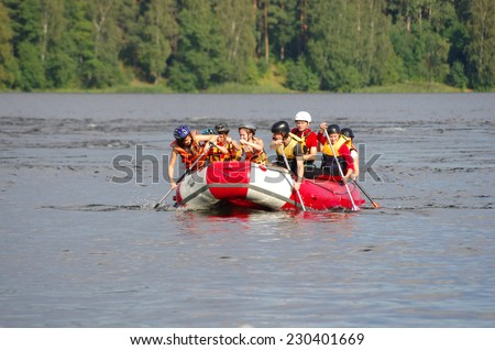LOSEVO - AUGUST 18: Whitewater rafting on AUGUST 18, 2012 RUSSIA. Unidentified persons enjoy whitewater rafting on the Vuoksi river in Losevo, Leningrad region, Russia - stock photo