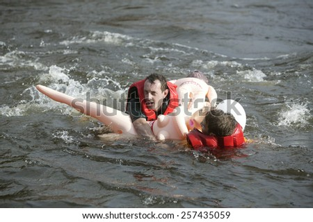 LOSEVO, LENINGRAD REGION, RUSSIA - AUGUST 26 : Participants in action at rafting on inflatable dolls Bubble Baba Challenge 2006 at Losevo Rapids in Losevo, Leningrad Oblast, RUSSIA on August 26, 2006.