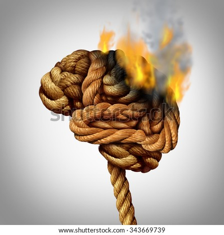 Losing brain function and memory loss due to dementia and Alzheimer's disease with the medical icon of a tangled rope shaped as a human thinking organ in flames and fire burning part of the anatomy. - stock photo