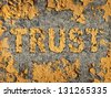 Losing trust and deteriorating integrity as a business concept with old fading yellow cracked paint on a rough cement wall as a metaphor of lost morality and illegal financial transactions. - stock photo
