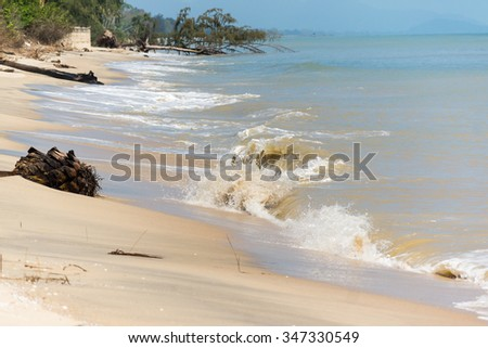 loss of coastal areas due to erosion of the waves - stock photo