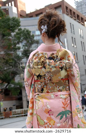 lost in the city (a Japanese woman looking for direction in the street) - stock photo