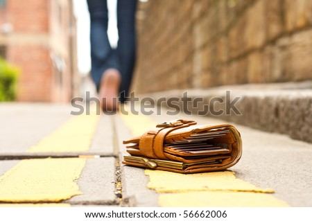 lost leather purce/wallet with money and cards - stock photo