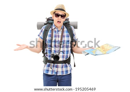 Lost male tourist holding a map and gesturing with hands isolated on white background - stock photo