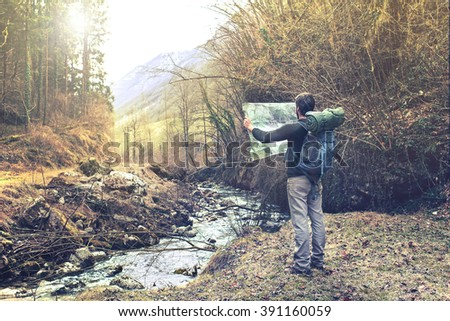 lost man observing map to find the the right way - stock photo