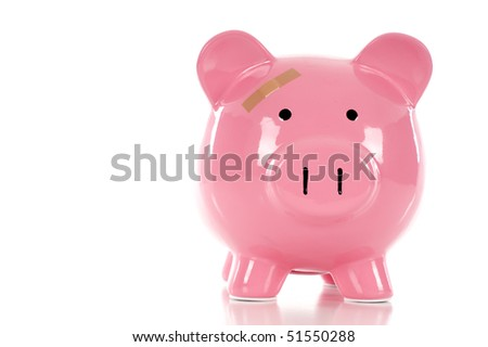Lost Money in Savings, Investment, in Debt Concept - Piggy Bank with band aid over a white background